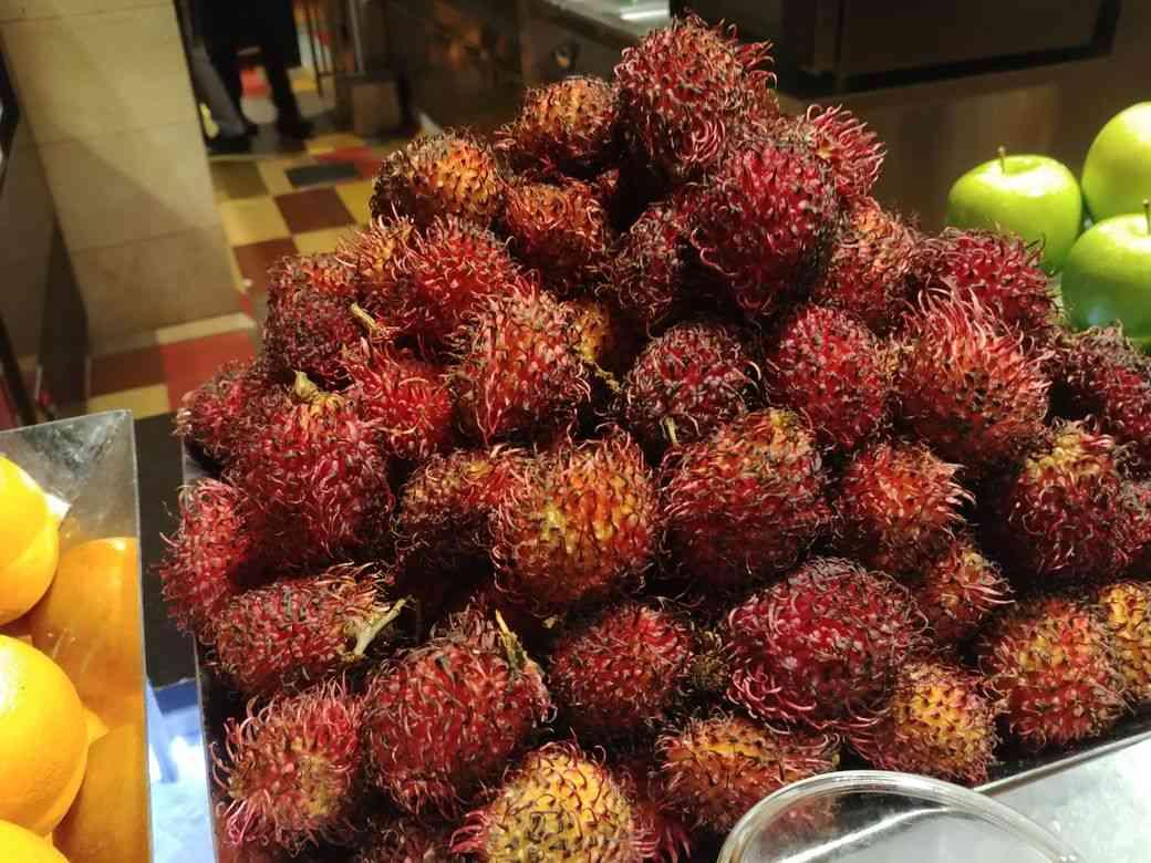 Fresh rambutan at the dessert station of The Grand Kitchen