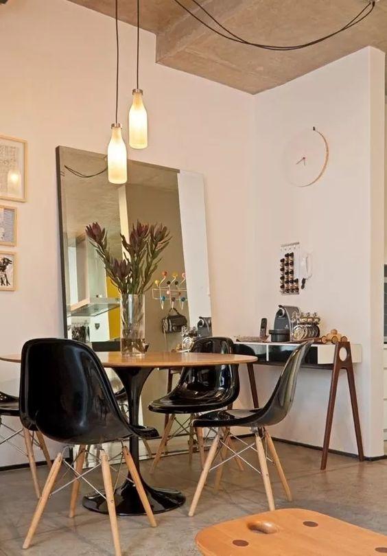 Decora o 12 ambientes com mesas redondas para inspirar voc jeito de casa blog de - Mesas redondas modernas ...