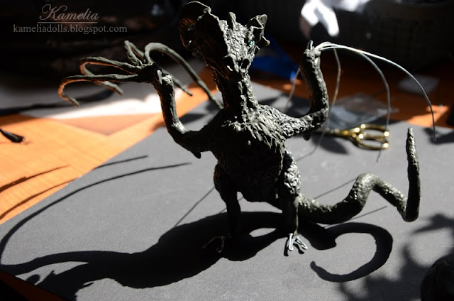Sculpting a dragon from modeline clay