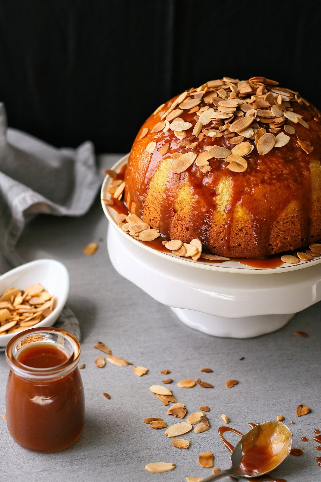 Sponge pudding with caramel sauce and toasted almonds.