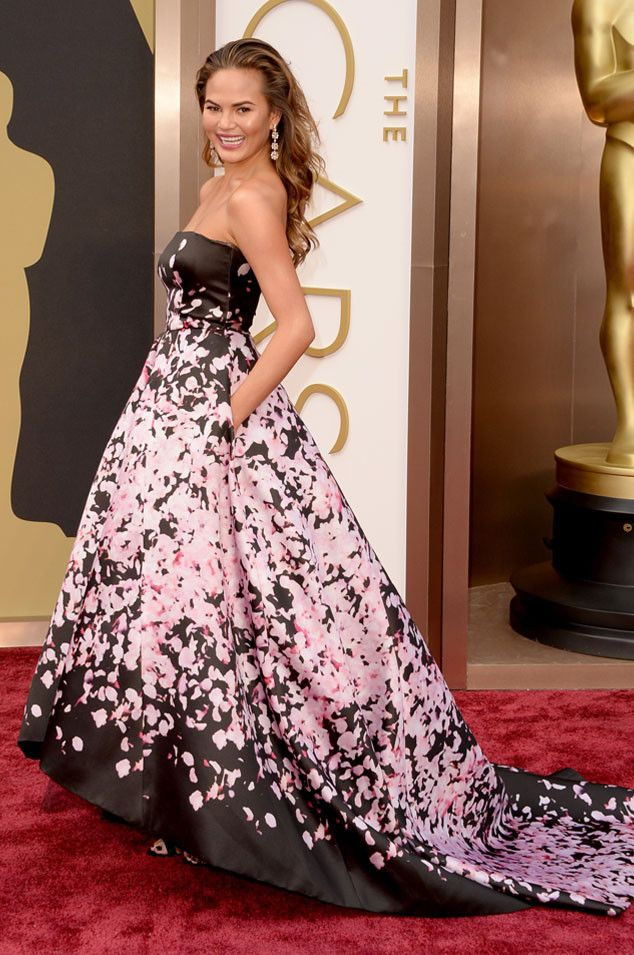 Chrissy Teigen in a floral print Monique Lhuillier gown at the Oscars 2014