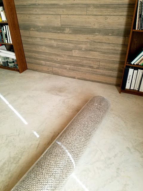 Using a remnant piece of carpet in unfinished basement.