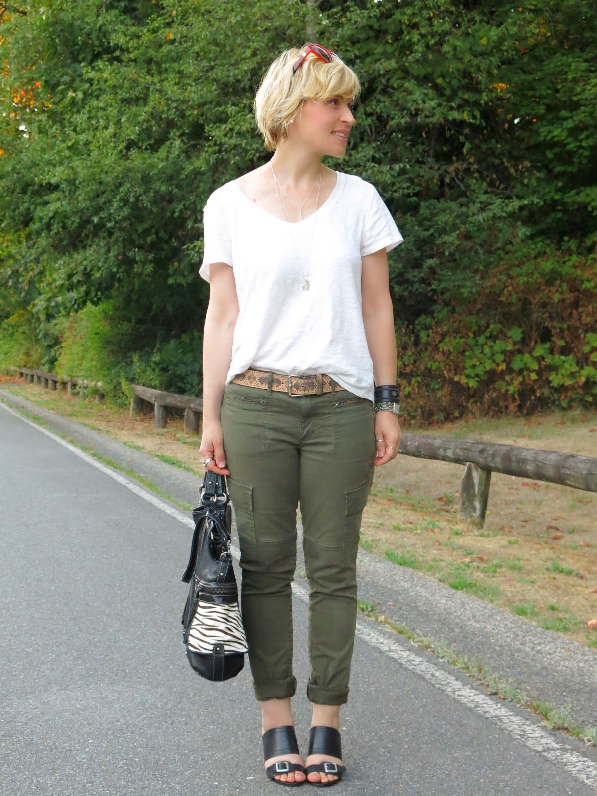 styling a basic white tee-shirt and skinny cargo pants with leather accessories