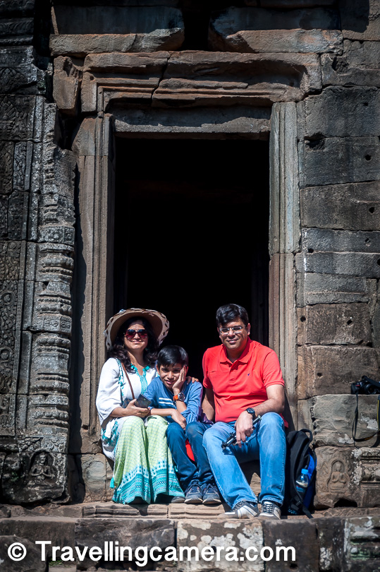 Apart from the faces, there are several other spots in Bayon where you can click some excellent photographs. My nephew Nishu kept making us pose at such spots. This is one photograph in which we made him pose for us with is parents.