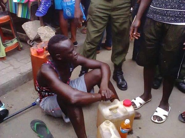Fuel Scarcity: Mob Manhandles Man Caught Selling Kerosene And Palm Oil As Petrol