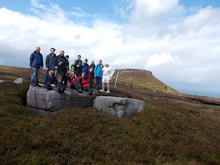 Walkers standing on Large rocks on Thor mountain, Leitrim