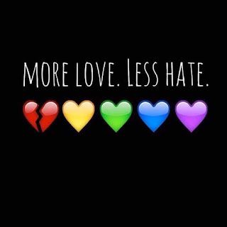 "Rainbow colored hearts in a row with first one (red) split in two with text: ""More love. Less hate."""
