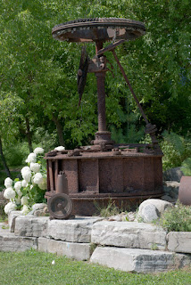 Old wheels and parts from a mill make unique garden art.