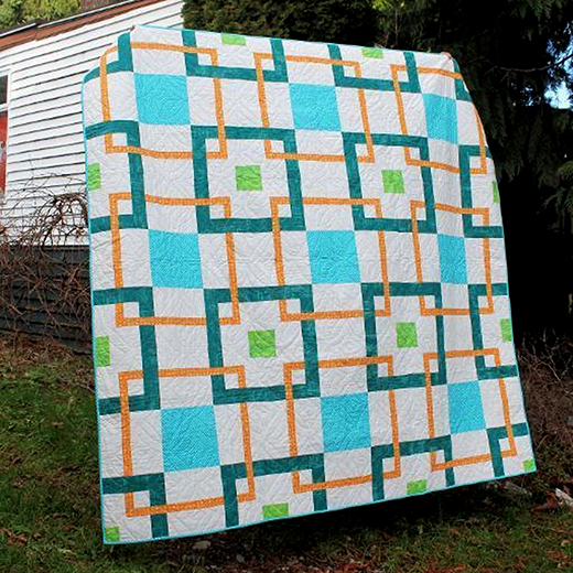 Linked In Quilt Designed by Stacey Day of Stacey in Stitches and quilted by Joan Nicholson, Fabrics are an assortment of Michael Miller collections