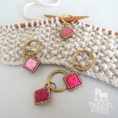 Set of pink tonal knitting stitch markers made with norwich stitch