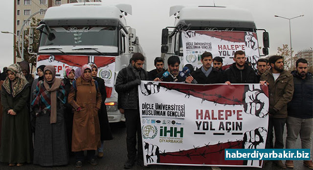 """DİYARBAKIR-İHH tarafından başlatılan ve kimi STK'larında destek verdiği """"Halep'e yol açın"""" kampanyası kapsamında toplanan 8 TIR yardım malzemesi Suriye'nin Halep şehrine gönderdi."""