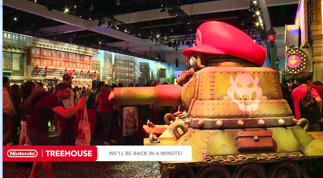 Nintendo E3 2017 booth Sherm Tank Super Mario Odyssey hat Bowser guy taking picture cannon