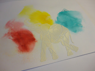 Elephant image in texture paste over red, yellow, blue bursts