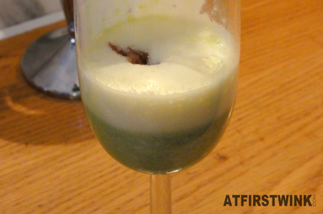 green pea cream foam soup with bacon snips (appetiser)