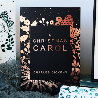 A Bookish Christmas:  A​ ​book​ ​cover​ ​that​ ​has​ ​a wonderfully​ ​Christmas​ ​feel to​ ​it.