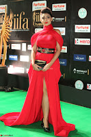 Apoorva in a Stunning Tight Leg Split Sleeveless Red Gown at IIFA Utsavam Awards 76.JPG