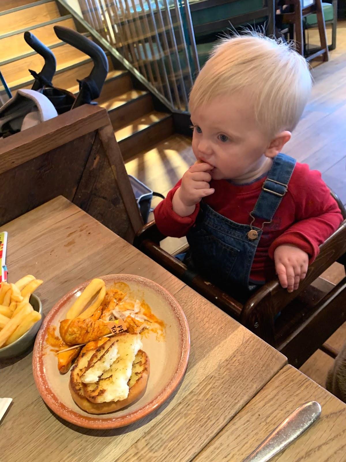 Baby reviewing Nandino's menu intu potteries