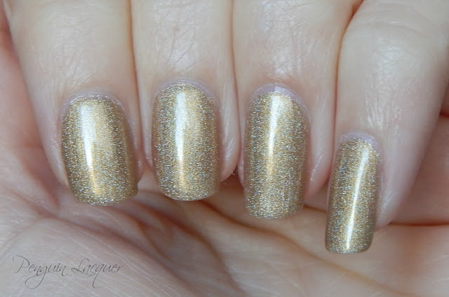 kiko holographic nail lacquer 002 golden champagne daylight nah