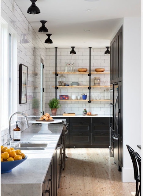 Stunning modern farmhouse kitchen with black and white and open shelving found on Hello Lovely