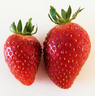 two ripe strawberries