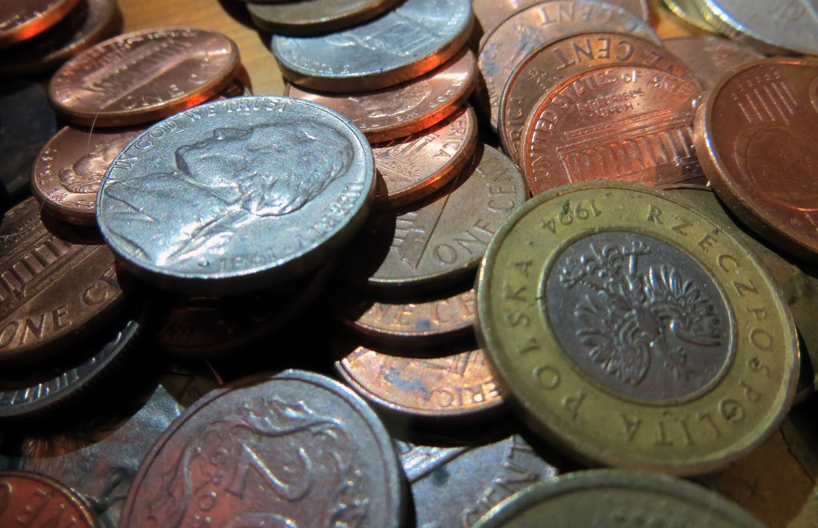 Money, coins, how to save for travelling, how to save for traveling, backpacking, travel, vacation, gap year, sabbatical, quit job and travel, money worries, budgeting, loans, debt,