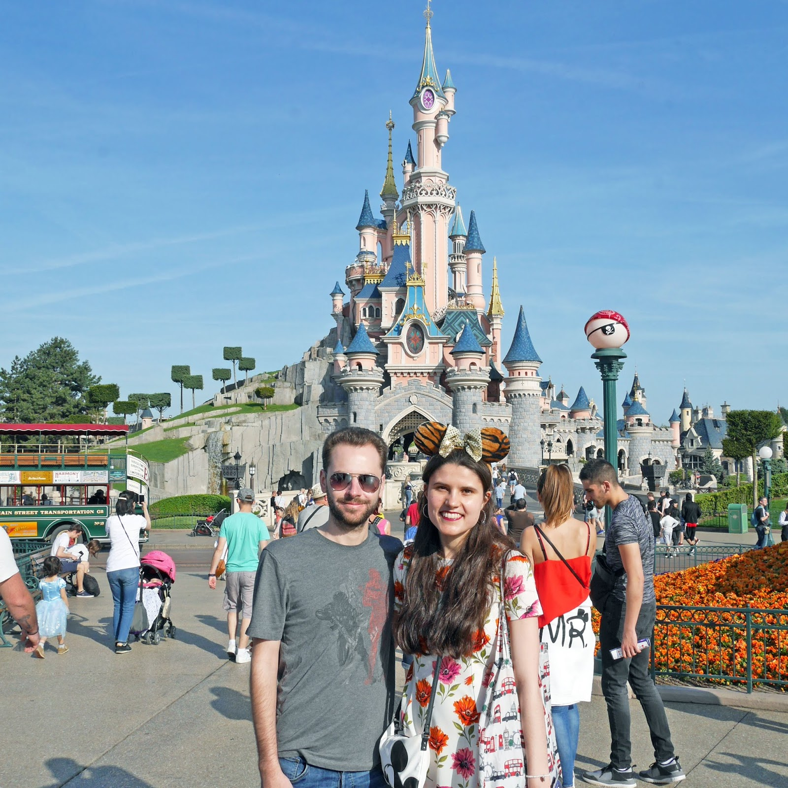 Kat Last and Stuart standing in front of the Castle at Disneyland Paris
