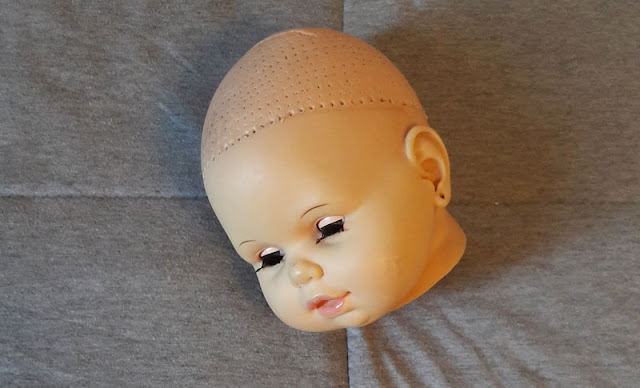 cabeça da boneca Cheirinho