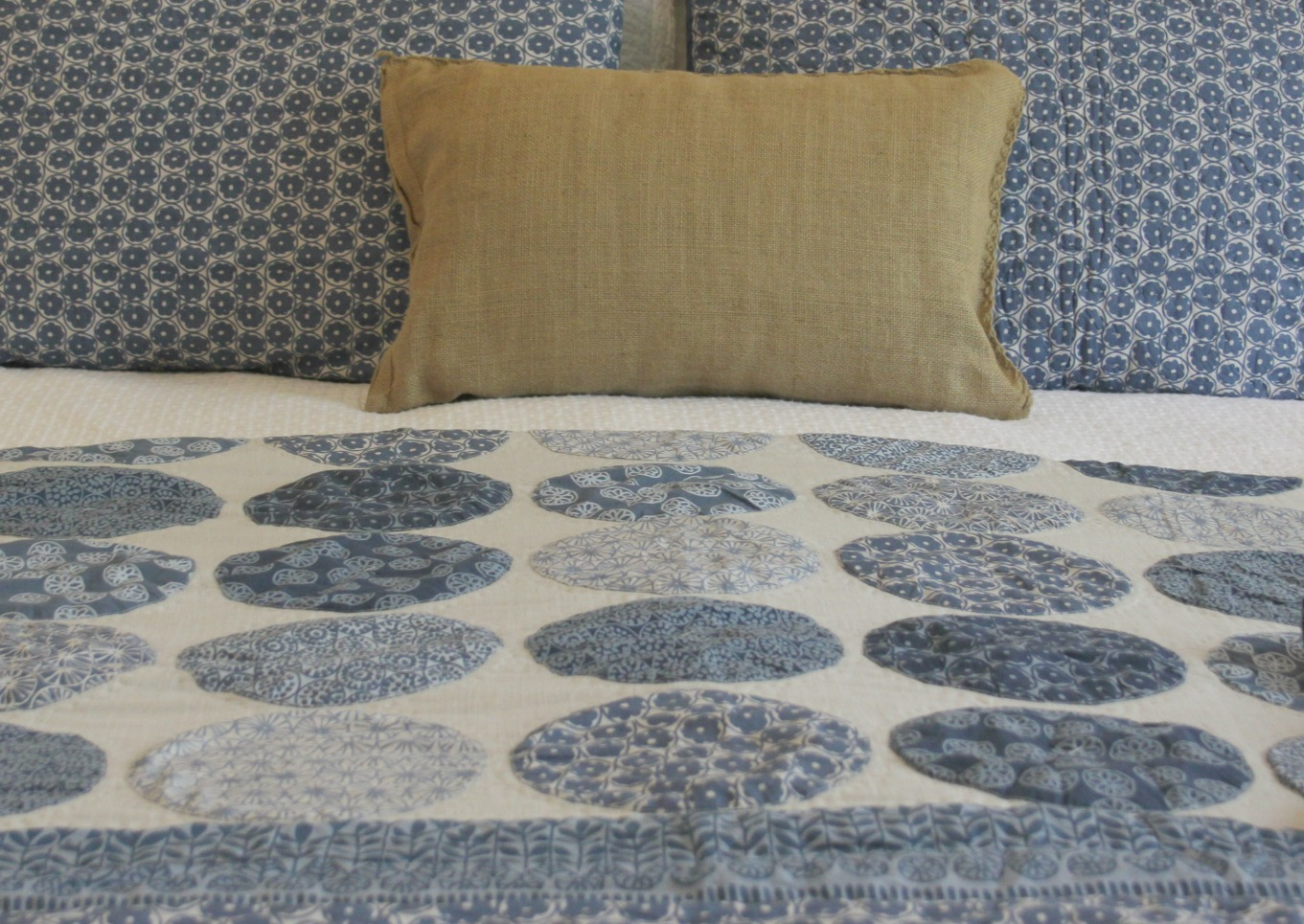 Beautiful blue moon quilt in bedroom with romantic country decor by Hello Lovely Studio