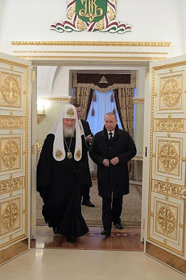 Vladimir Putin, Patriarch Kirill of Moscow and All Russia.