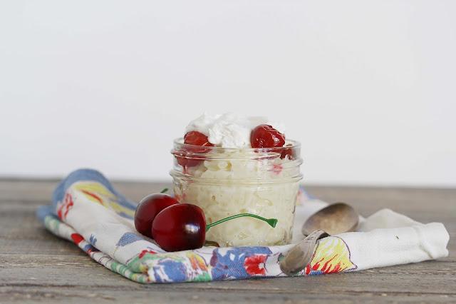 Creamy vegan gluten-free almond rice pudding with fresh cherries