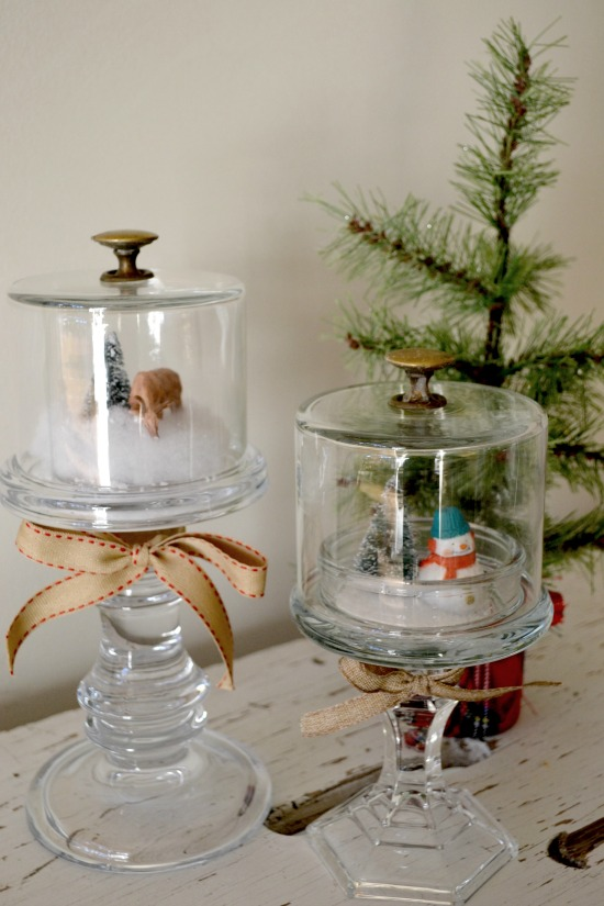 winter scene snow globes on DIY candle stick pedestals www.homeroad.net