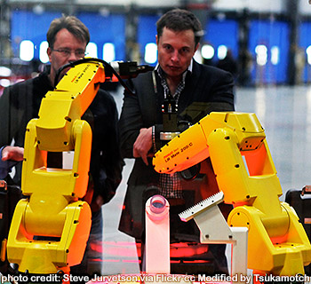 FANUC Robot Assembly Demo - The yellow robot arms dance through an assembly demo for Elon Musk and the rest of the tour group that visited the reopening of the former NUMMI plant, now Tesla Motors. photo credit by Steve Jurvetson