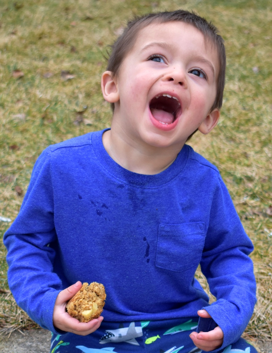 Kid eating muffin