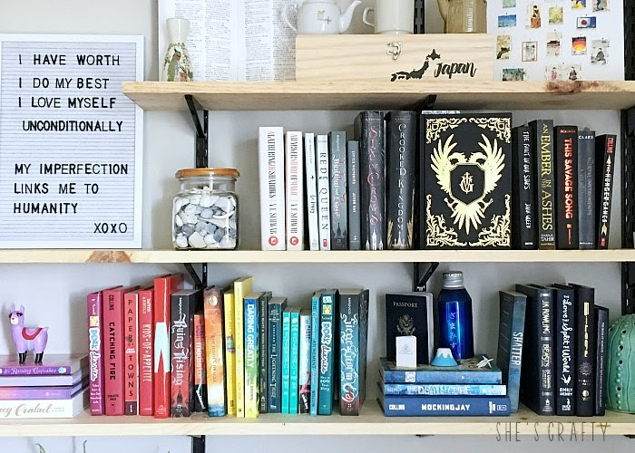 Styling open wall shelves in teen room with rainbowtized books