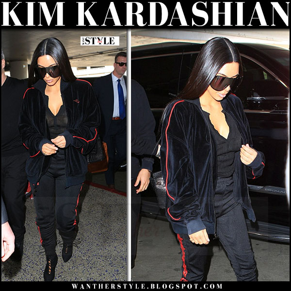 Kim kardashian in velvet jacket, black red stripe sweatpants yeezy with oversized sunglasses rick owens what she wore