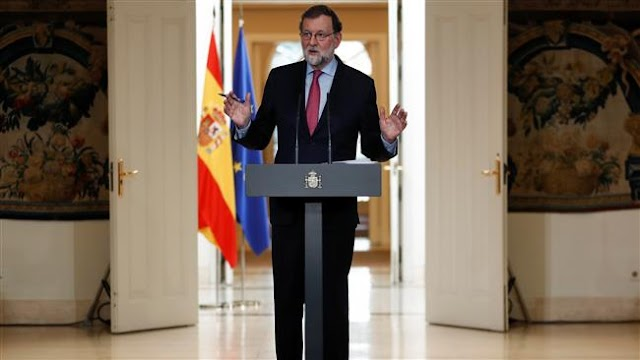 Spain's Prime Minister Mariano Rajoy urges Catalan parliament formation in January