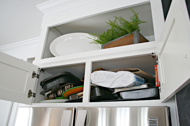 Organizing the space above the refrigerator