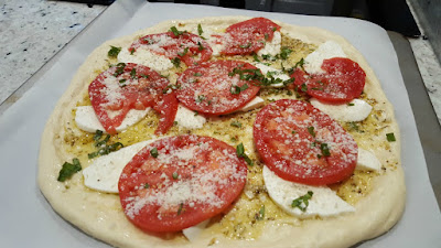 Tomato and Mozzarella Pizza Ready for the Oven