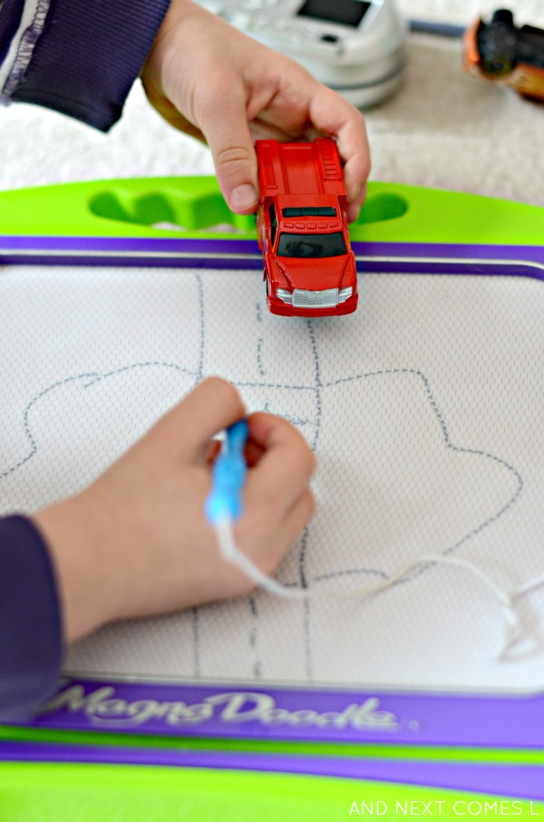 Drawing roads on a Magna-Doodle from And Next Comes L