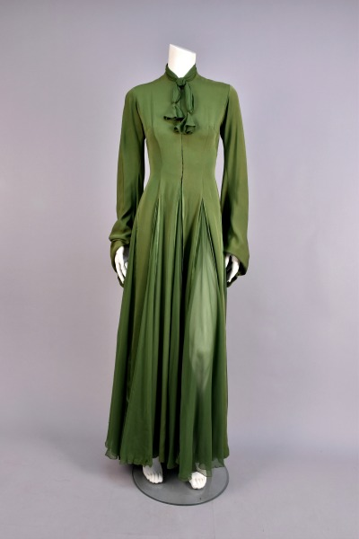 "Green silk crepe gown worn by Judy Garland in 1954's ""A Star Is Born"" displayed on a dress form"