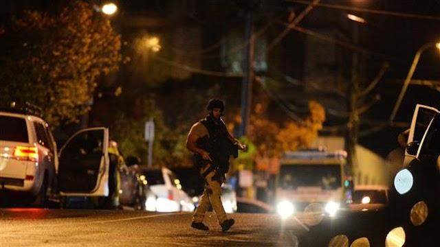 Hostage taker killed, three police officers injured in Melbourne 'terrorist incident'