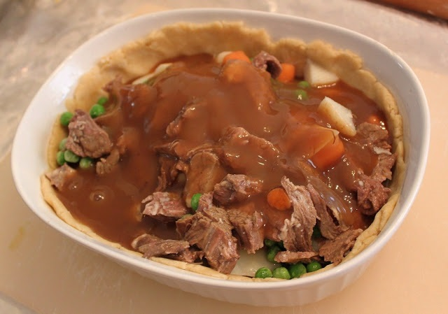 This is a homemade pot pie using pie crust for the pastry top and bottom, filled with meats, gravy and mxed vegetables