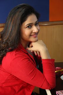 Poonam Bajwa Stills At Radio City In Red Dress (2)