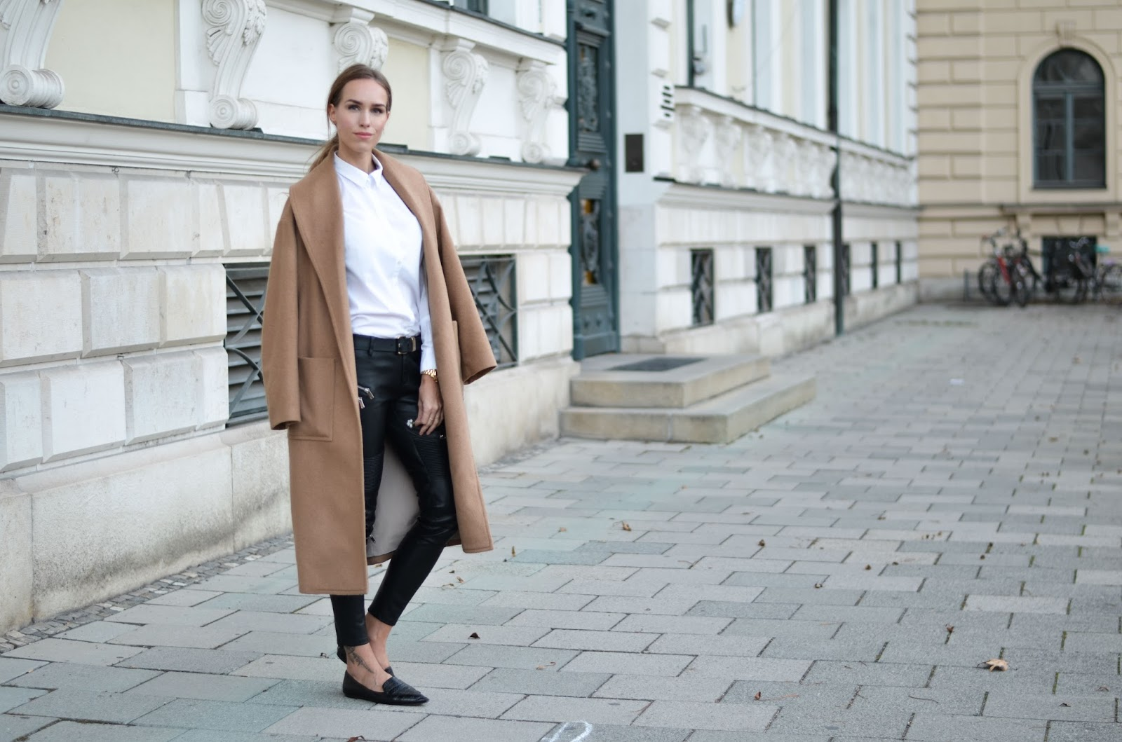 kristjaana mere camel coat leather pants white shirt point toe flats minimalist fashion