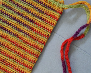 Close-up of WIP Project Bag made in variegated sock yarn. The i-cord drawstrings can be seen on the right hand side.