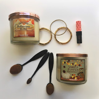 bath and body works, white barn, candle, vanilla, pumpkin, marshmallow, butter cream, icing, roller lash, benefit cosmetics, pineapple, makeup, mascara, necklace, jewelry, aesthetic, flat lay, bangles, oval brushes