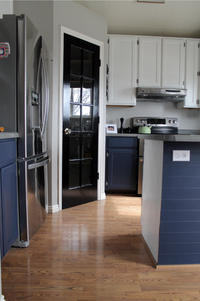 Navy painted base cabinets chris loves julia Best white paint for kitchen cabinets behr