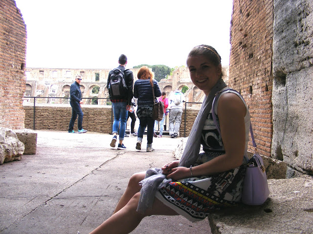 Full outfit sitting at the Colosseum