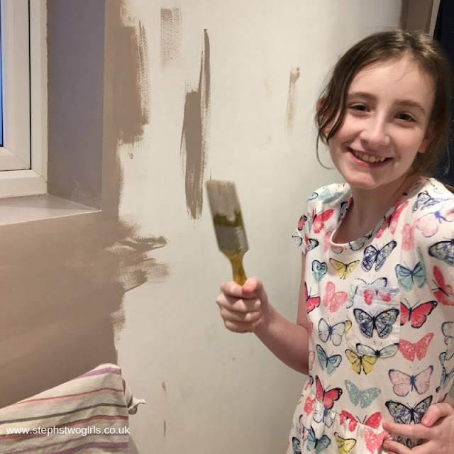 Sasha with a paintbrush and a smile