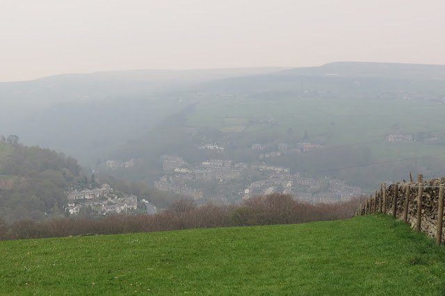 A hazy view of the town in the valley below.